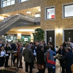 People networking during reception of 1Europe Kick Off Event