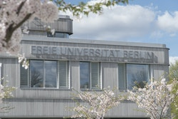 FU Berlin building with cherry trees in bloom